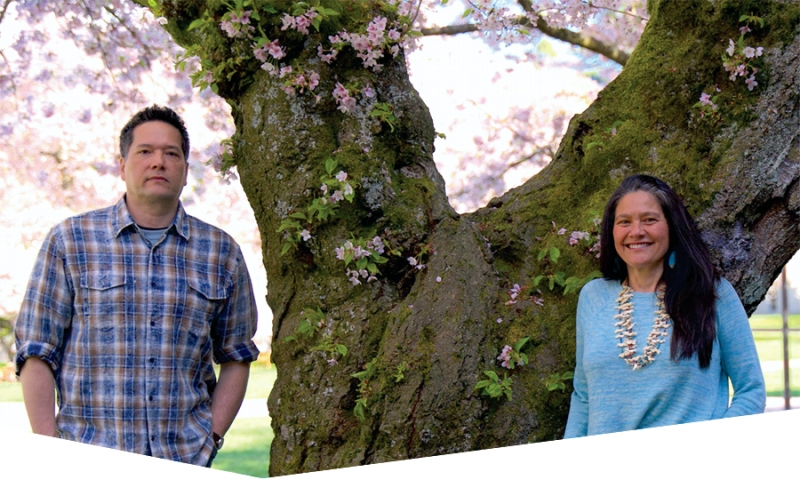 Brother-and-sister team Keith and Chenoa Egawa. A flowering tree as background.