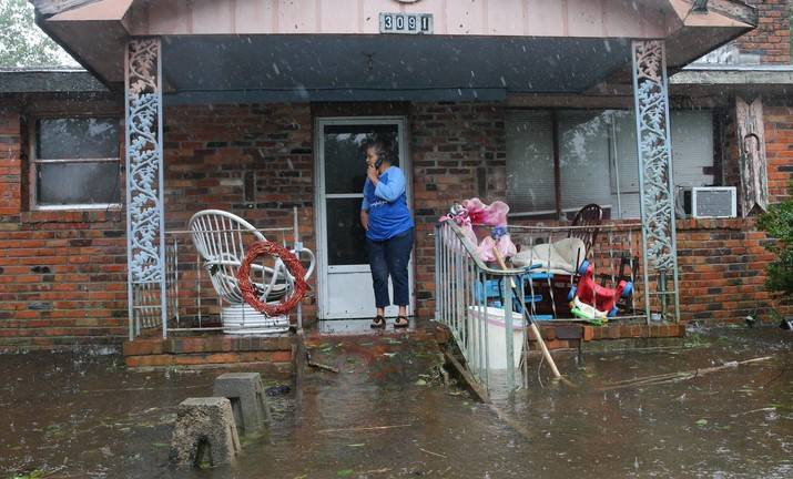 A woman on cellphone calls for help at her flooded residence in Lumberton, North Carolina, on Sept. 15, 2018 in the wake of Hurricane Florence.
