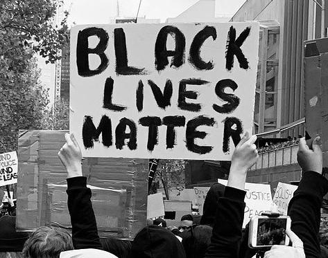 Black Lives Matter sign held by protester.