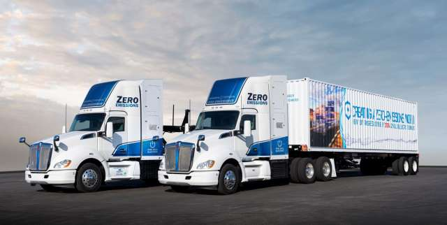 Two white and blue big-rigs.