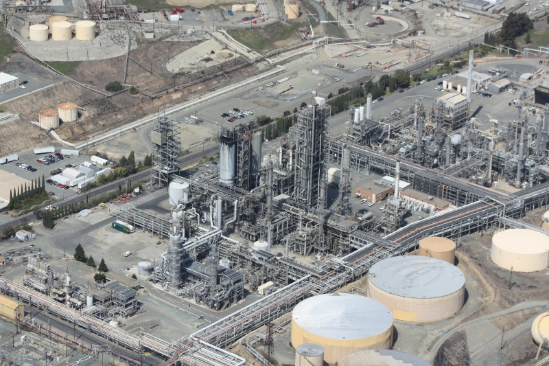Oil refinery with storage tanks.