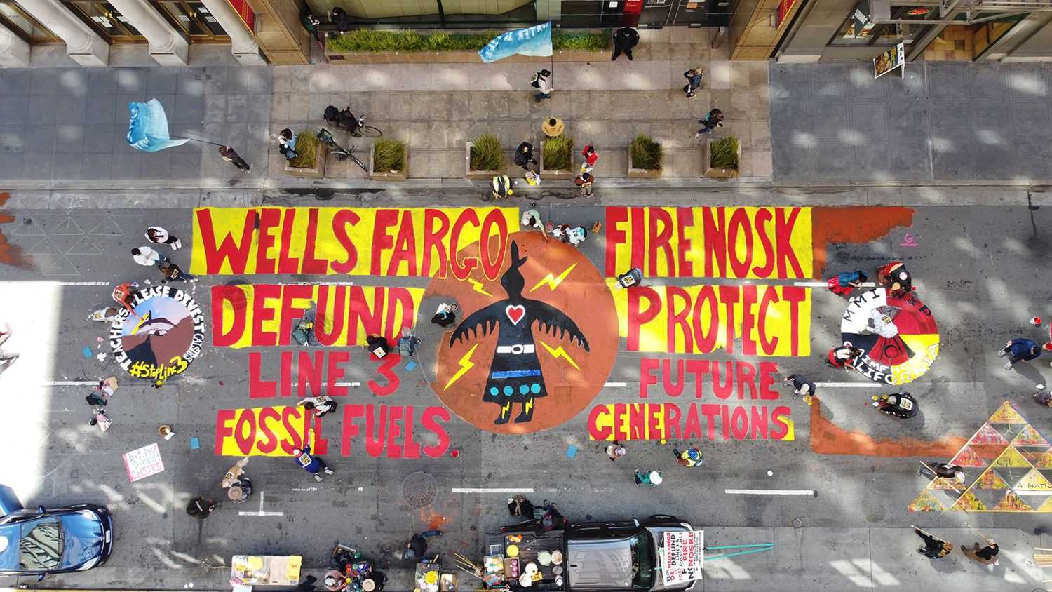 Drone photo of painting the street outside Wells Fargo bank.