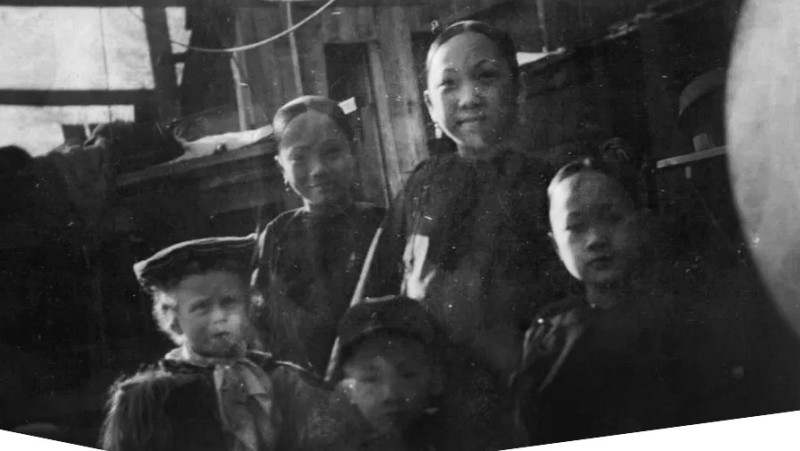 Asian American Old West. Five children, including four who are Chinese, standing in front of a building in Deadwood, first established as a mining town in South Dakota, undated.