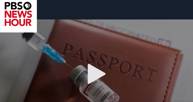 PBS. Needle in vaccine bottle, atop a leather Passport case.