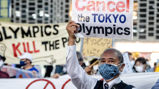 Tokyo demonstration. Cancel the Tokyo Olympics. Olympics KILL the Poor.