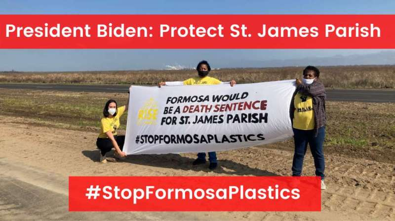 President Biden: Protect Se. James Parish. #StopFormosaPlastics. Three youth holding a banner in the wind.