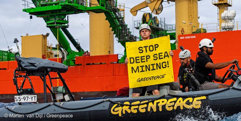 Greenpeace Boat with sign: Stop Deep Sea Mining.