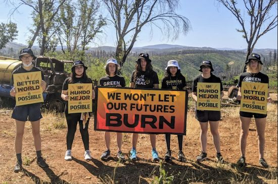 Generation On Fire Weekend. Seven youths in shorts holding sign, We won't let our Futures Burn.