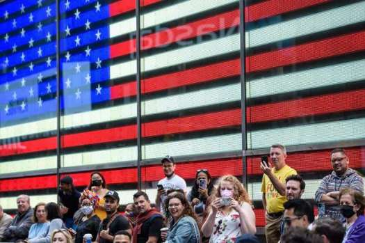 People watch a performance during a pop up event in Times Square.