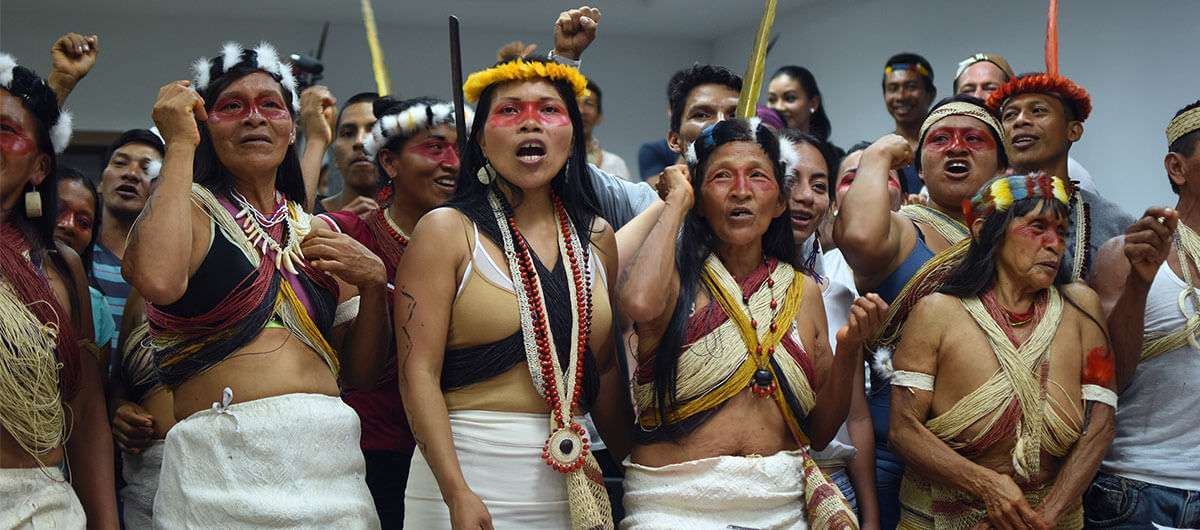 A room full of worked-up Indigenous Women in costume.