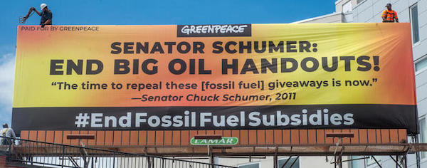 Workers install a billboard with a message for Senator Chuck Schumer a few blocks from his Prospect Park home. The billboard sends a clear message to Sen. Schumer: End Big Oil Handouts. In May 2011, Schumer said Òthe time to repeal these giveaways is nowÓ when talking about tax subsidies for big oil on the floor of the senate.