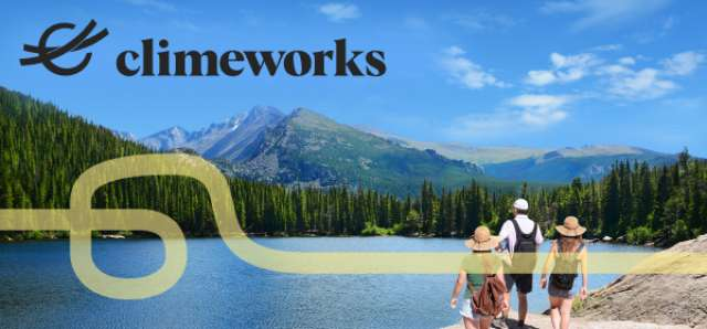 Climeworks logo and image. Hiking to a forested lake edge.